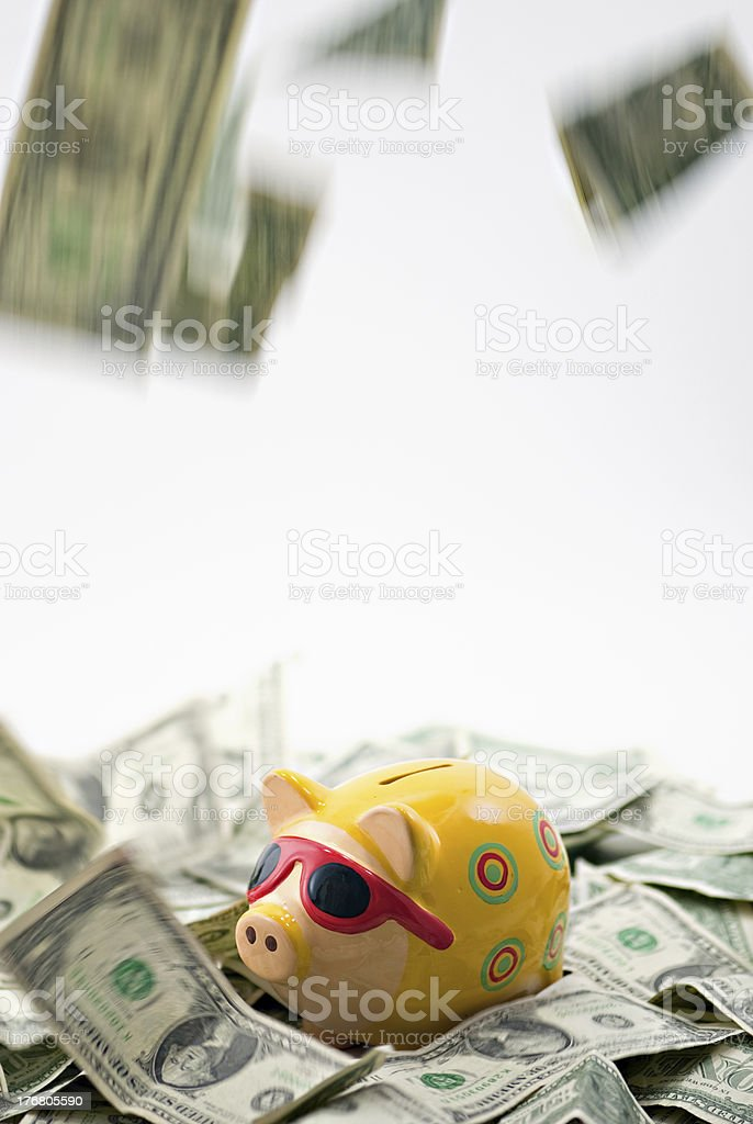 Piggy Bank with Sunglasses in a Rain Storm of Money royalty-free stock photo