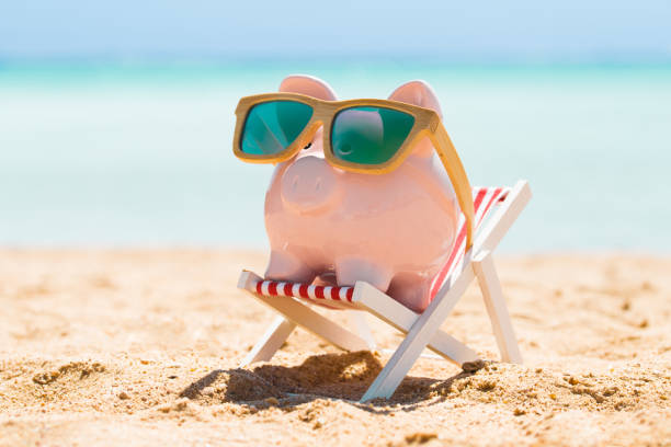Piggy Bank With Wooden Sunglasses On The Deck Chair Pink Piggy Bank Wearing Wooden Sunglasses Kept On The Deck Chair At Beach 40 kilometre stock pictures, royalty-free photos & images