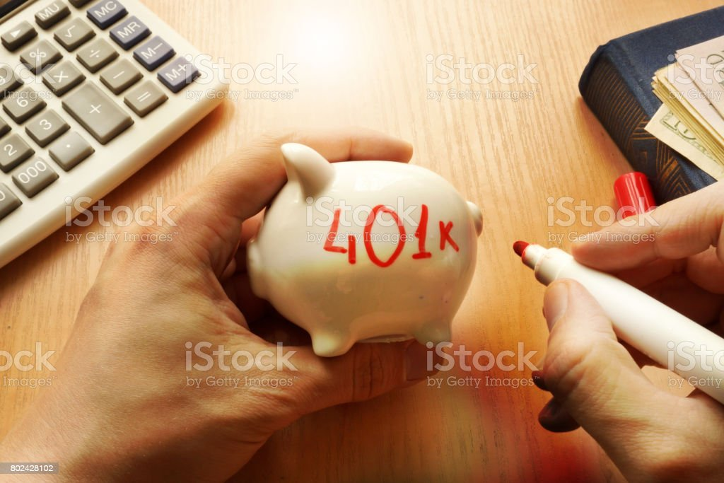 Piggy bank with word 401k. Retirement plan concept. stock photo
