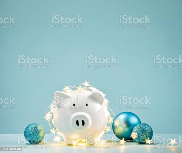 Piggy bank wrapped in a string of christmas lights picture id1047381030?b=1&k=6&m=1047381030&s=612x612&h=cal o1nmchf bno69ucrxddkmiuteezrwmakkhvirpq=