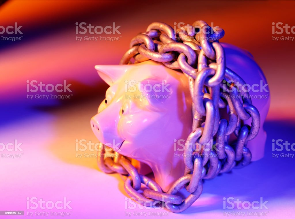 Piggy Bank Wrapped in Chains royalty-free stock photo