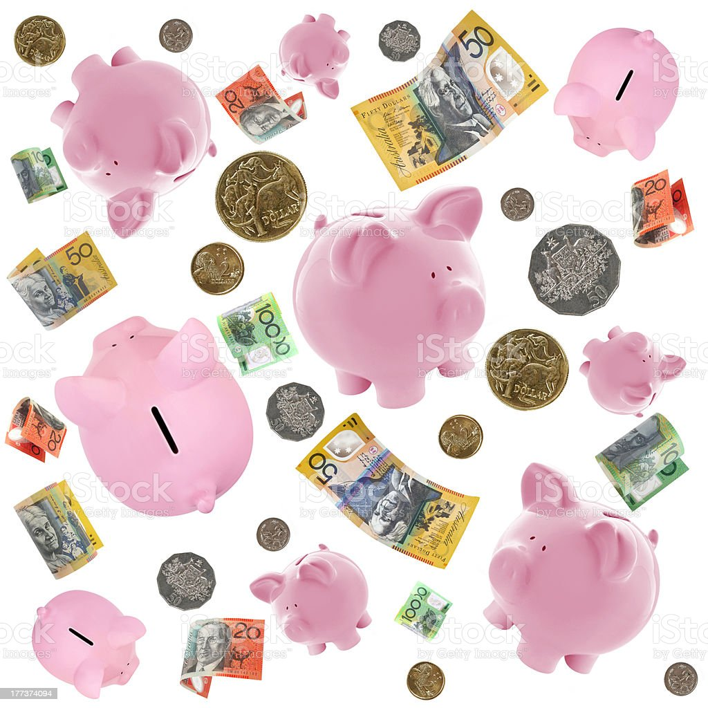 Piggy Banks and Australian Money Falling over White stock photo