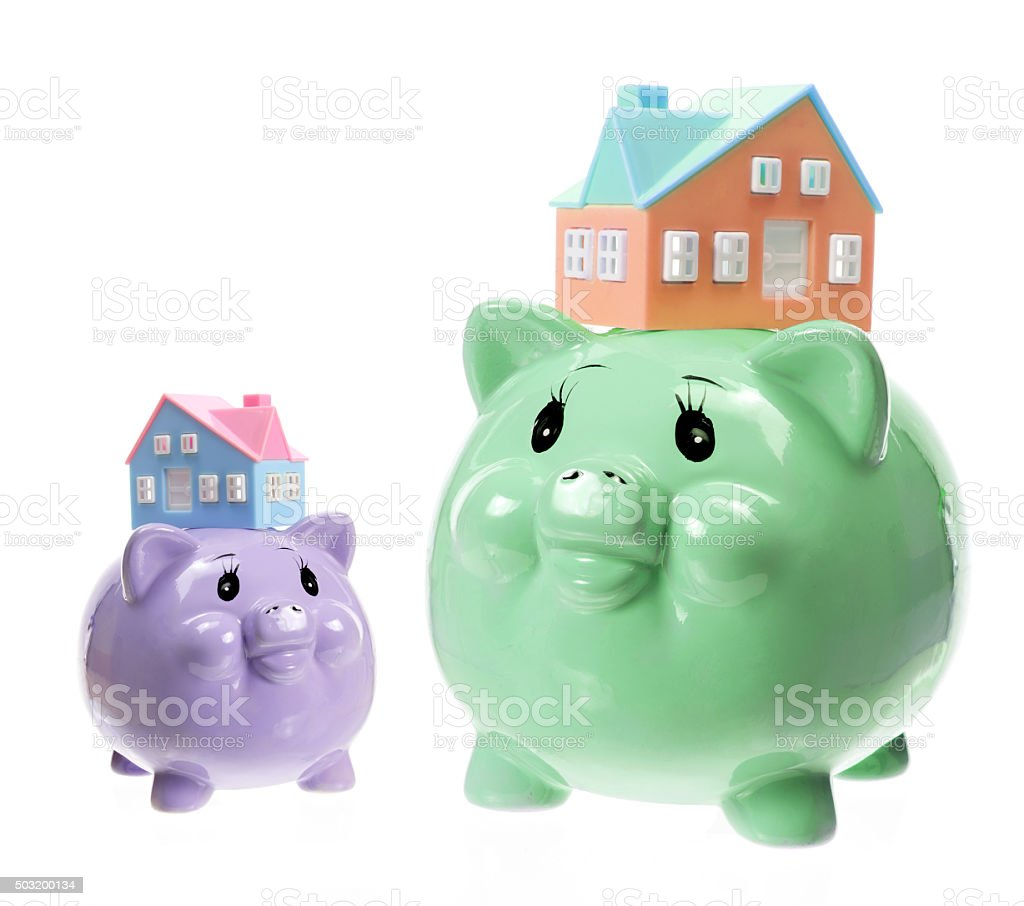 Piggy Banks and Toy Houses stock photo