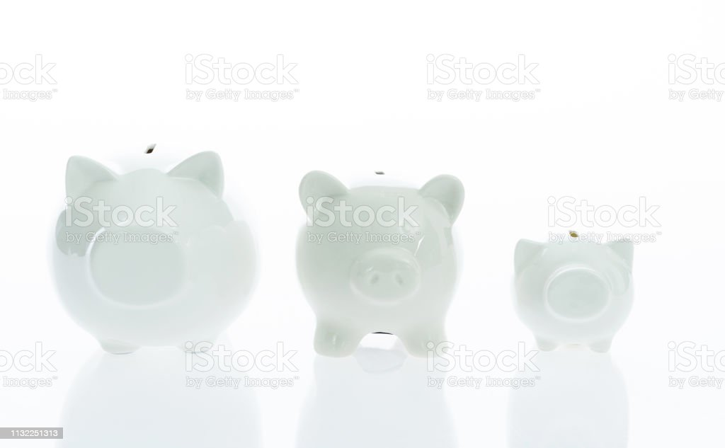 Piggy banks on white background stock photo