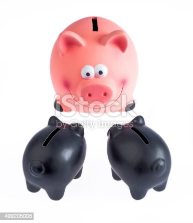 Low angle view of piggy bank on white background.