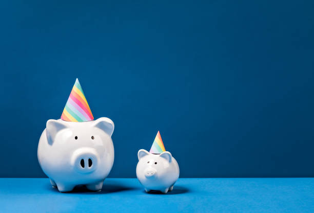 Piggy Banks wearing Party Hats stock photo