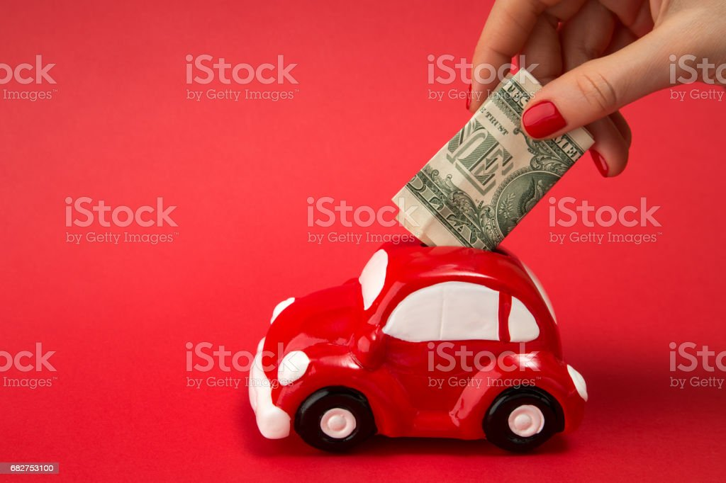 piggy in the form of the machine and the dollar stock photo