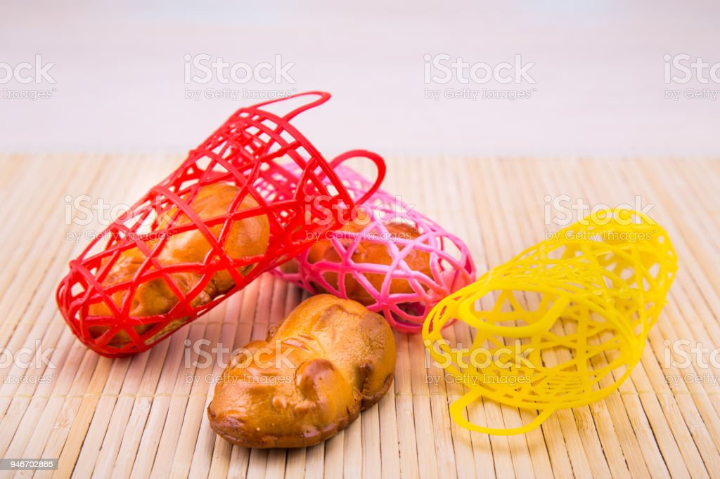 Piggy moon cakes in colorful basket, Chinese mid-autumn delicacies stock photo