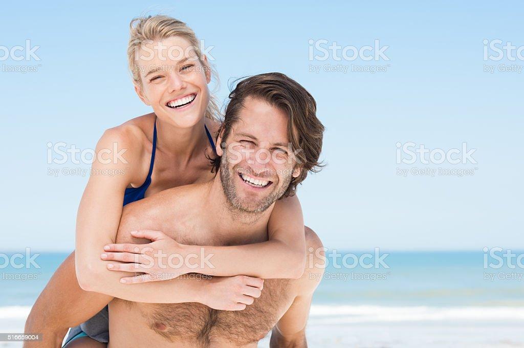 Piggyback on beach stock photo