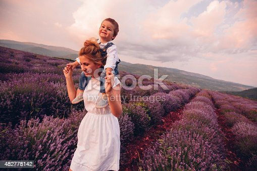 Photo of mother and her son having fun at the lavender field