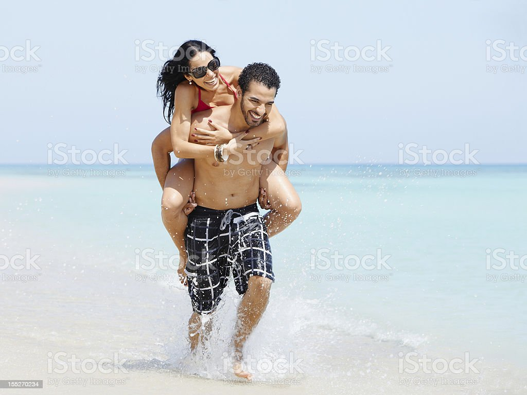 piggyback ride with happy man and woman royalty-free stock photo