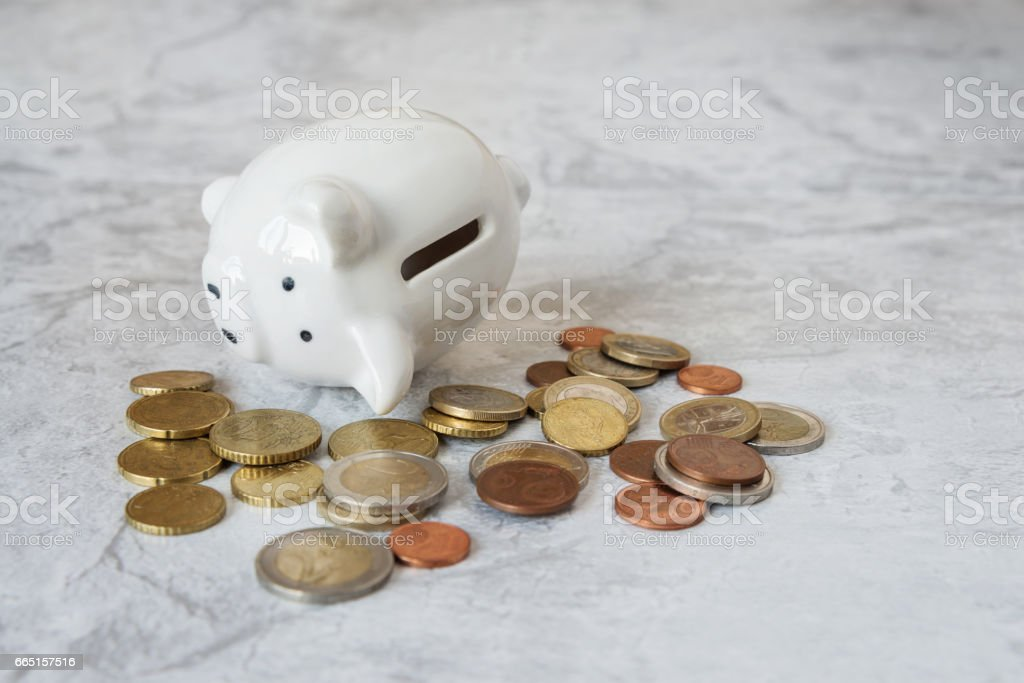 Piggybank and metal coins stock photo
