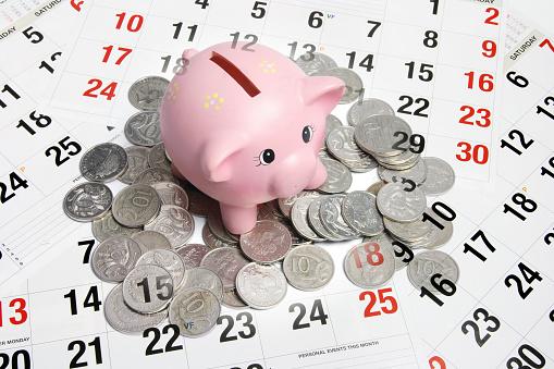 Piggybank Coins And Calendar Stock Photo - Download Image Now