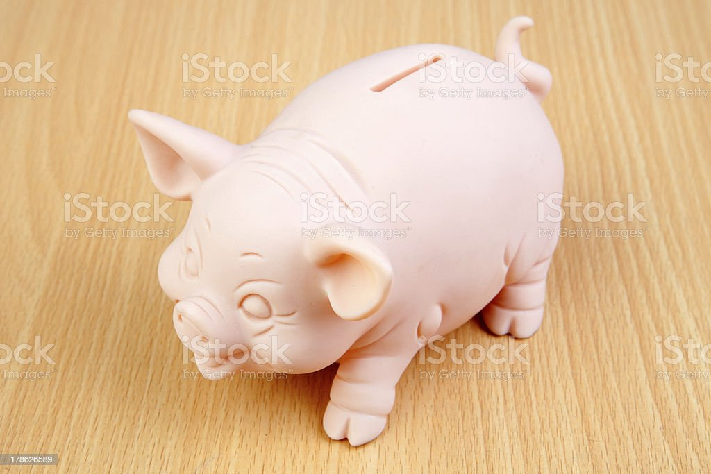 Piggy-bank on a wooden table royalty-free stock photo