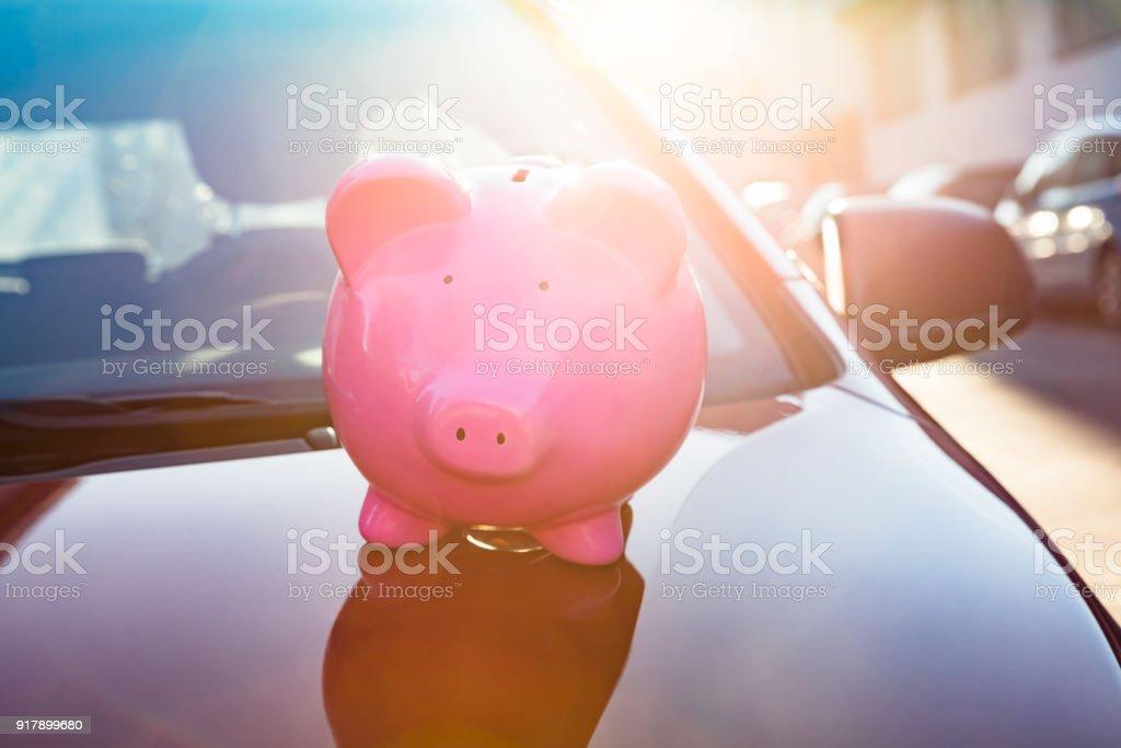 Piggybank On Car stock photo