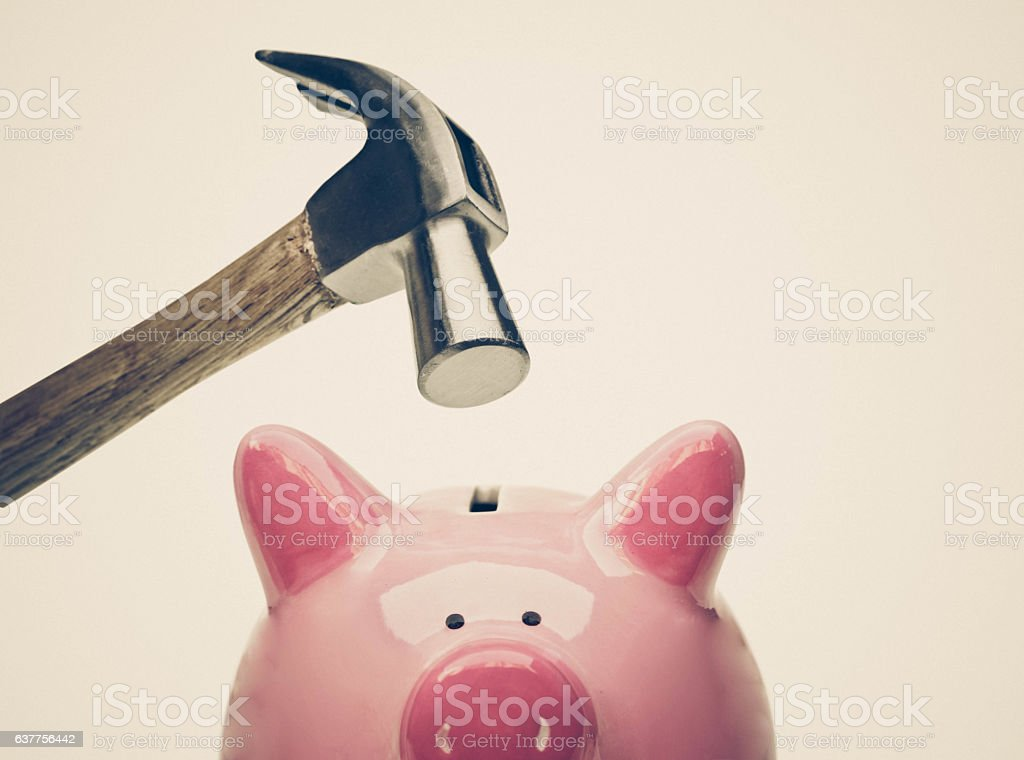 piggybank A sad pink piggy bank is about to be hit by a hammer isolated Backgrounds Stock Photo