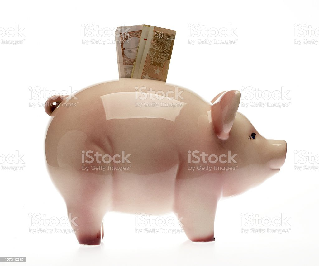 Piggybank with Euro bills royalty-free stock photo