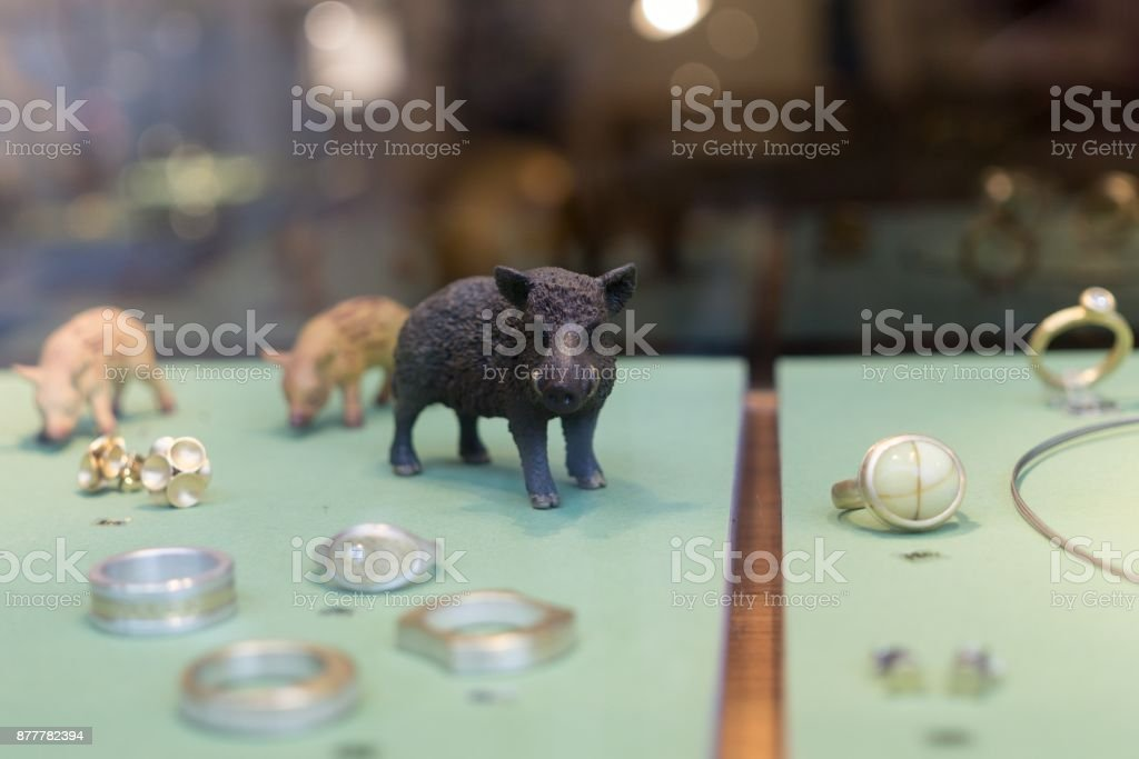 Pigs in the exposition of jewelery shop in Hamburg. stock photo