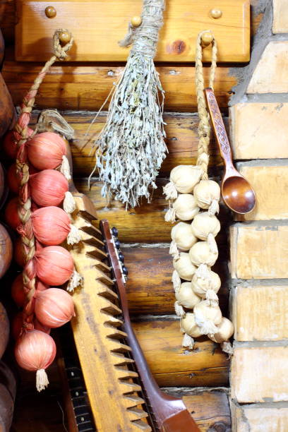 Cтоковое фото Pigtail with onion and garlic, vintage Washing board, iron, bandura. Ancient traditional Ukrainian lifestyle
