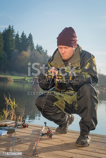 914030378istockphoto Pike fishing on the pond spinning. 1182586066