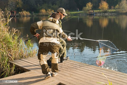 914030378istockphoto Pike fishing on the pond spinning. 1182586068