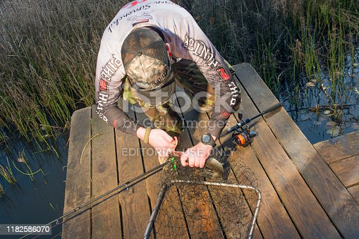 914030378istockphoto Pike fishing on the pond spinning. 1182586070