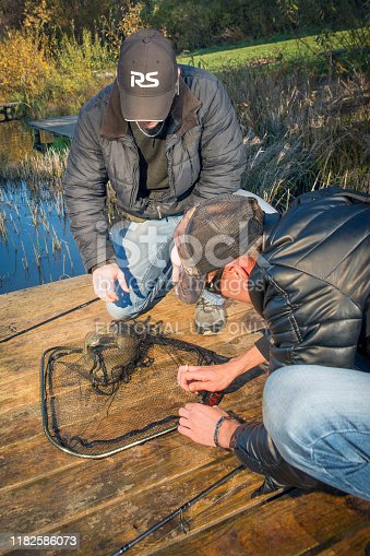 914030378istockphoto Pike fishing on the pond spinning. 1182586073