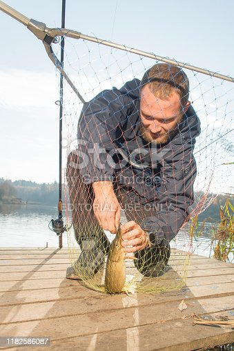 914030378istockphoto Pike fishing on the pond spinning. 1182586087