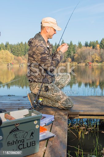 914030378istockphoto Pike fishing on the pond spinning. 1182586397