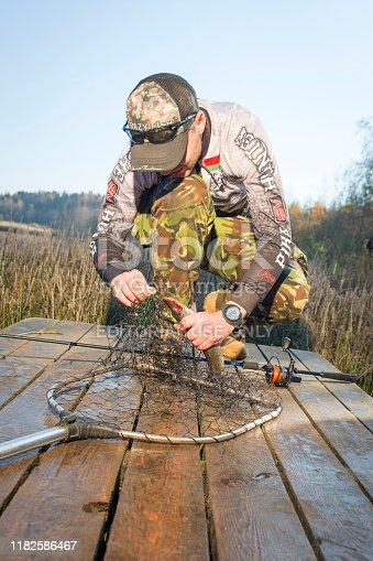 914030378istockphoto Pike fishing on the pond spinning. 1182586467