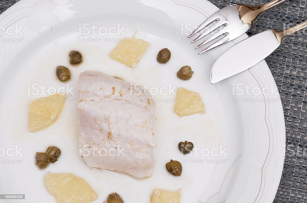 Pike perch with lemon and capers royalty-free stock photo