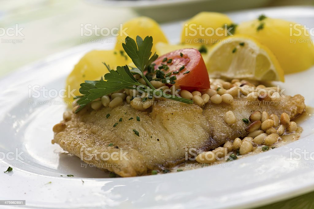 Pike Perch with Potatoes and Pine Seeds royalty-free stock photo