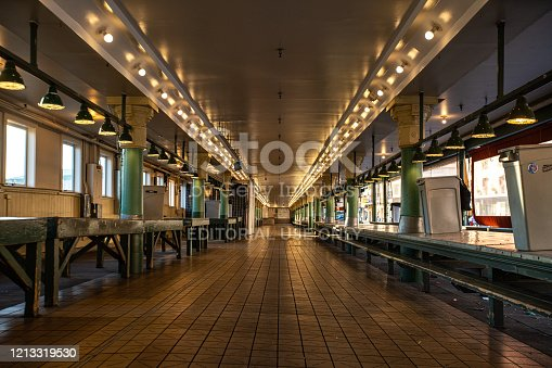 A usually exceptionally crowded and lively marketplace, Pike Place in Seattle is a ghost of its former self, shuttered and empty.