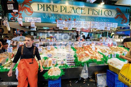 Seattle, WA, USA - JULY 21:  Fish Market at Pike Place Market in downtown Seattle on July 24, 2018 in Seattle, Washington.