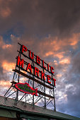 Seattle, USA - Apr 8, 2018: The famous neon public market sign at Pike Place Market at sunset.