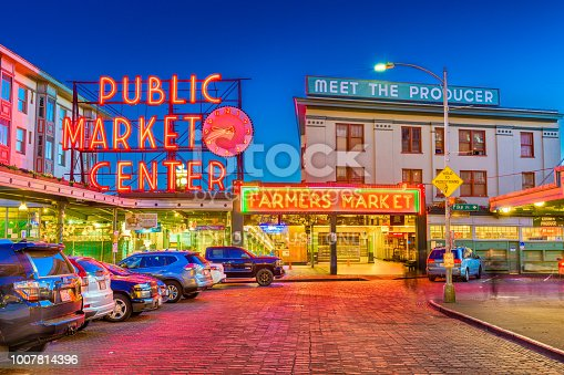 Seattle, Washington - July 2; 2018: Pike Place Market at night. The popular tourist destination opened in 1907 and is one of the oldest continuously operated public markets in the United states.