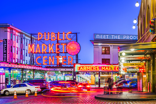 Seattle, Washington, USA - July 2; 2018: Pike Place Market at night. The popular tourist destination opened in 1907 and is one of the oldest continuously operated public markets in the United states.