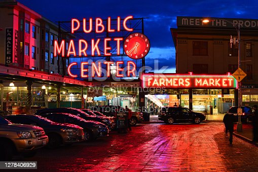 Seattle, WA, USA October 23 The lights of the Pike Place Market in Seattle reflect in the rainy streets