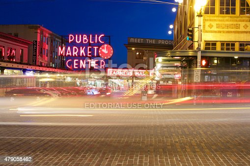Seattle, USA - June 24, 2015: Pike Place Public Market Center Sign at Night with Light Trails