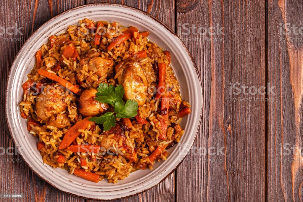 Pilaf (biryani) on a wooden background stock photo