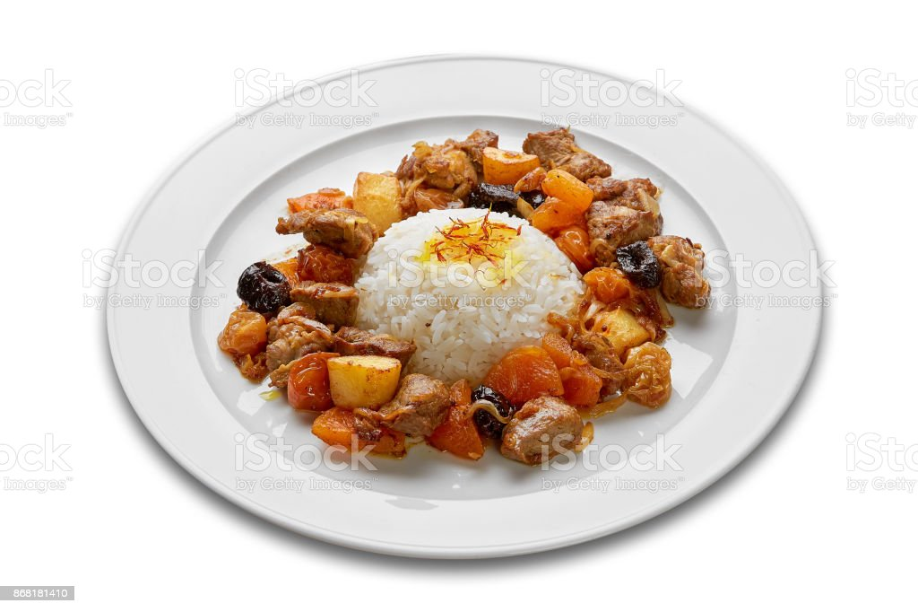 Pilaf with prunes and dried apricots stock photo