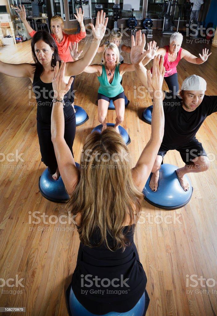 Pilates Class standing on Balance Balls stock photo