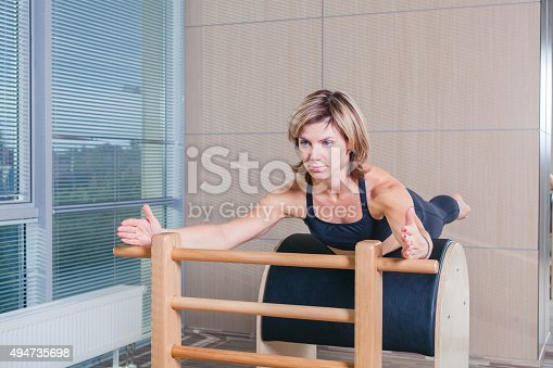 873786782istockphoto Pilates, fitness, sport, training and people concept - smiling woman 494735698