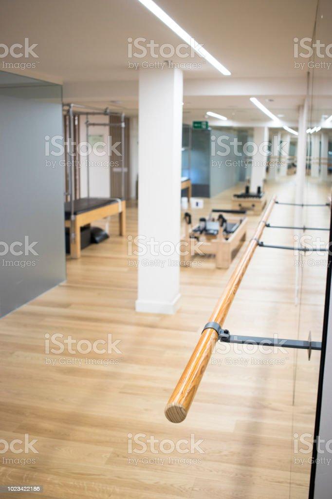 Pilates fitness studio gym room with training dance ballet bar for