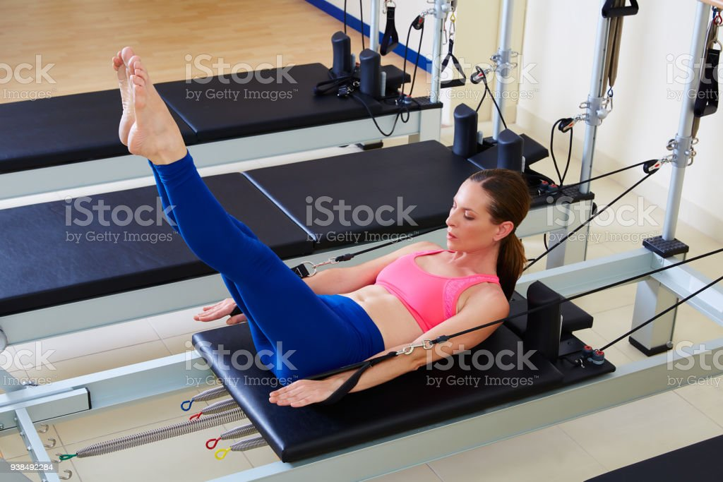Pilates reformer woman hundred exercise stock photo