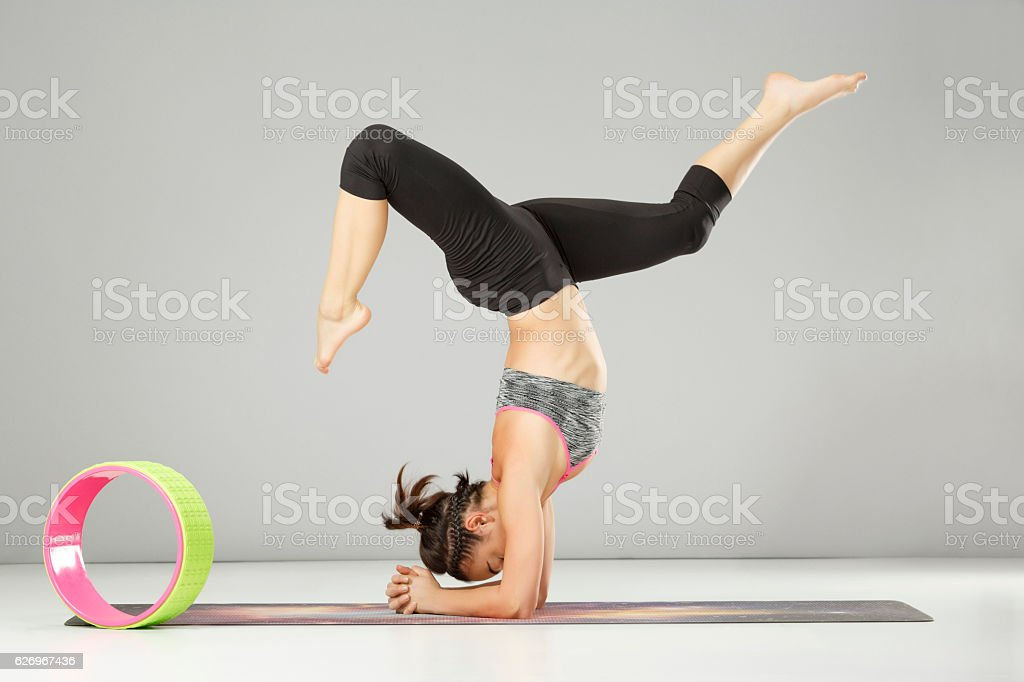 Pilates Stretching Training Woman Practicing Advanced Yoga Poses Yoga Wheel Stock Photo Download Image Now Istock