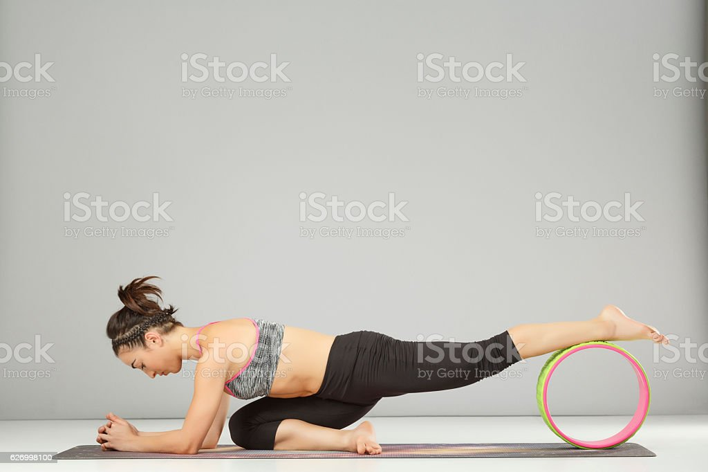 Pilates Stretching Training Yoga Wheel Poses Woman Practicing Advanced Yoga Stock Photo Download Image Now Istock