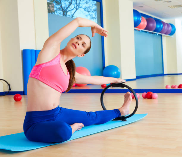 Woman Pilates Chair Exercises Fitness Stock Photo: Royalty Free Pilates Ring Pictures, Images And Stock