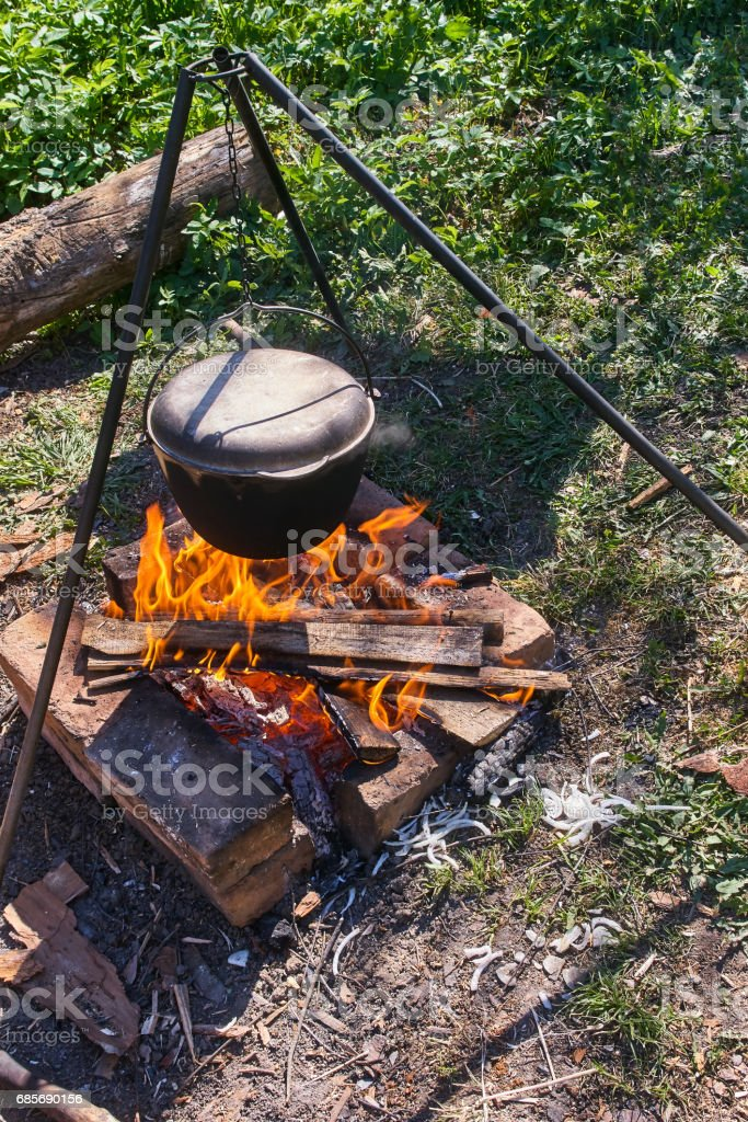 Pilau in cauldron on fire royalty-free stock photo