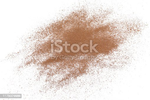 istock pile cocoa powder top view on white background. 1175029986